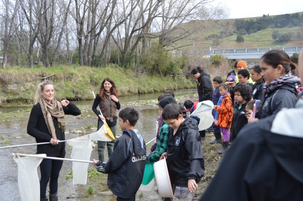 Amy-Rose Hardy instructing wananga participants on the process for gathering macroinvertebrate from the Makatote Stream.